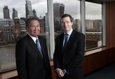 Nikkei Chairman Tsuneo Kita (L) and Financial Times Chief Executive Officer John Ridding pose for a photograph at the Financial Times headquarters in London, Britain November 30, 2015. REUTERS/Suzanne Plunkett