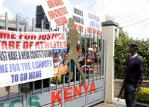 A policeman is seen outside the gates of Riadha House the Athletic Kenya (AK) Headquarters during a protest in capital Nairobi November 23, 2015.  REUTERS/Noor Khamis