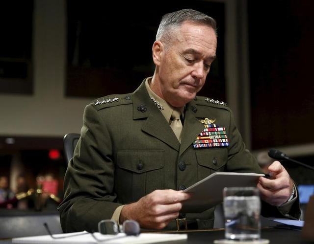 Joint Chiefs of Staff Chairman USMC General Joseph Dunford, Jr. looks at his notes before testifying at a Senate Armed Forces Committee  hearing on ''United States Strategy in the Middle East'' in Washington October 27, 2015. REUTERS/Gary Cameron