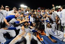 Kansas City Royals players pose for a team photo after defeating the New York Mets in game five of the World Series at Citi Field in New York, November 1, 2015.  Mandatory Credit: Jeff Curry-USA TODAY Sports
