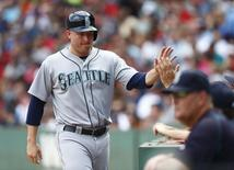 Seattle Mariners right fielder Mark Trumbo (35) celebrates after scoring a run against the Boston Red Sox during the third inning at Fenway Park. Mandatory Credit: Mark L. Baer-USA TODAY Sports