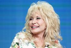 "Executive producer Dolly Parton participates in the NBCUniversal ""Dolly Parton's Coat of Many Colors"" panel at the Television Critics Association (TCA) Summer 2015 Press Tour in Beverly Hills, California August 13, 2015.  REUTERS/Jonathan Alcorn"
