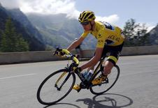 Team Sky rider Chris Froome of Britain wears the race leader's yellow jersey as he speeds downhill during the 110.5-km (68.6 miles) 20th stage of the 102nd Tour de France cycling race from Modane to Alpe d'Huez in the French Alps mountains, France, in this picture taken July 25, 2015.  REUTERS/Stefano Rellandini/Files