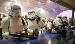 People dressed as Storm troopers stand at a bar as they pose for a photograph holding cans of beer at the  'For The Love of The Force' Star Wars fan convention in Manchester, northern England, December 4, 2015.  REUTERS/Phil Noble