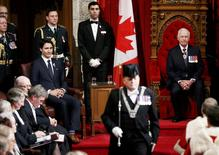 Canada's Governor General David Johnston (R) and Prime Minister Justin Trudeau look on prior to the delivery of the Speech from the Throne in the Senate chamber on Parliament Hill in Ottawa, Canada December 4, 2015. REUTERS/Chris Wattie