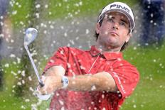 Bubba Watson of the U.S. hits out of a bunker on the fourth hole during the second round of the WGC-HSBC Champions golf tournament in Shanghai, China, November 6, 2015. REUTERS/Aly Song