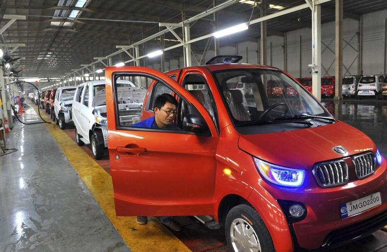 An employee assembles an electric car along a production line at a factory in Qingzhou, Shandong province, China, October 31, 2015. REUTERS/China Daily