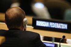 Президент России Владимир Путин слушает выступление председателя КНР Си Цзиньпина на Генассамблее ООН в Нью-Йорке. 28 сентября 2015 года. Россия попросила Совет безопасности ООН провести закрытые обсуждения военных действий Турции в Сирии и Ираке, сообщили дипломаты в понедельник. REUTERS/Mike Segar