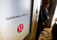 Yogawear retailer Lululemon Athletica Inc's logo is pictured as security personnel guard the entrance to the company's annual general meeting in Vancouver in this June 11, 2014 file photo. REUTERS/Ben Nelms/Files