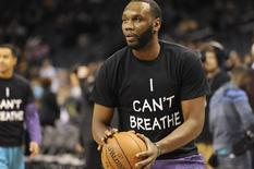Dec 13, 2014; Charlotte, NC, USA; Charlotte Hornets center Al Jefferson (25) wears an I Cant Breathe shirt before the game against the Brooklyn Nets at Time Warner Cable Arena. Mandatory Credit: Sam Sharpe-USA TODAY Sports