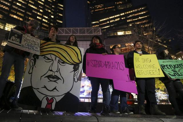 People take part in an anti-Donald Trump, pro-immigration protest in the Manhattan borough of New York December 10, 2015.     REUTERS/Carlo Allegri