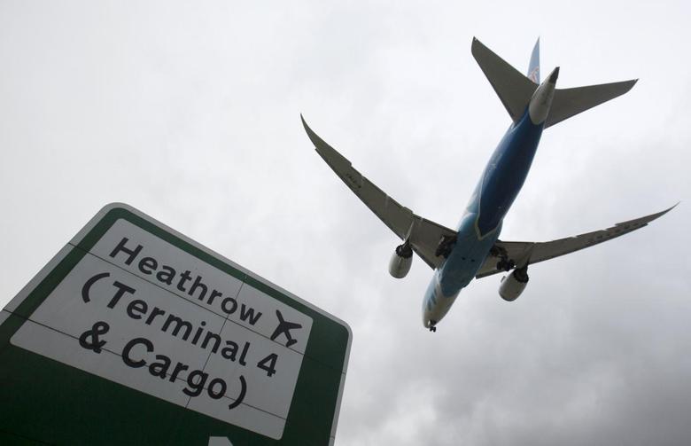An aircraft lands at Heathrow Airport near London, Britain, December 11, 2015. REUTERS/Neil Hall