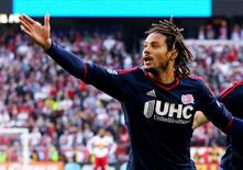 Nov 23, 2014; Harrison, NJ, USA; New England Revolution midfielder Jermaine Jones (13) reacts after scoring the game-winning goal in the 85th minute against the New York Red Bulls during the Eastern Conference Championship at Red Bull Arena. The Revolution defeated the Red Bulls 2-1. Mandatory Credit: Andy Marlin-USA TODAY Sports