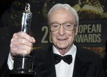 British actor Sir Michael Caine poses with award for European Actor after the 28th European Film Award ceremony in Berlin, Germany December 12, 2015. REUTERS/Clemens Bilan/Pool