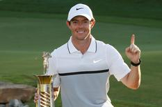 Golf - DP World Tour Championship - Jumeirah Golf Estates, Dubai, United Arab Emirates - 22/11/15. Northern Ireland's Rory McIlroy celebrates with the trophy after winning The Race to Dubai. Action Images via Reuters / Paul Childs