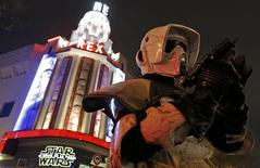 """A man dressed as a Storm Trooper poses in front of the Grand Rex cinema before the screening of""""Star Wars: The Force Awakens"""" in Paris, France, December 16, 2015.    REUTERS/Christian Hartmann"""
