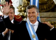 Argentina's President Mauricio Macri waves after being sworn-in as president at Casa Rosada Presidential Palace in Buenos Aires, Argentina, December 10, 2015. REUTERS/Marcos Brindicci