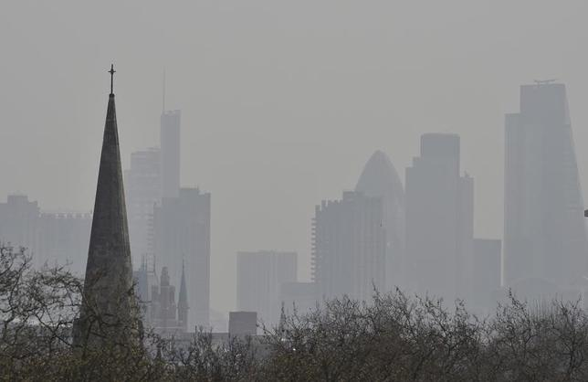 The City of London financial district is seen from Primrose Hill as high air pollution obscures the skyline over London April 10, 2015. REUTERS/Toby Melville