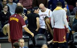 Dec 17, 2015; Cleveland, OH, USA; Jason Day, black shirt, reacts after his wife Ellie Day was run over while sitting in the front row by Cleveland Cavaliers forward LeBron James (23) in the fourth quarter of a game between the Cleveland Cavaliers and the Oklahoma City Thunder at Quicken Loans Arena. Mandatory Credit: David Richard-USA TODAY Sports