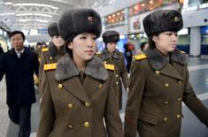 Members of the Moranbong Band of North Korea arrive at Beijing International Airport before departing from Beijing, China in this photo taken by Kyodo December 12, 2015. Mandatory credit REUTERS/Kyodo