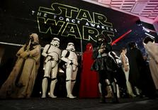 "Moviegoers wait before the first showing of the movie ""Star Wars: The Force Awakens"" at the entrance of a movie theatre in Tokyo, Japan, December 18, 2015. REUTERS/Issei Kato"