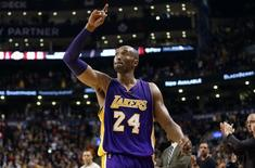 Dec 7, 201 Los Angeles Lakers guard Kobe Bryant (24) salutes the crowd reaction as he exits the game for the last time in Canada against the Toronto Raptors at Air Canada Centre. The Raptors beat the Lakers 102-93. Tom Szczerbowski-USA TODAY Sports