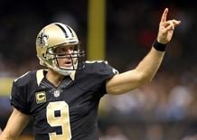 Dec 21, 2015; New Orleans, LA, USA; New Orleans Saints quarterback Drew Brees (9) gestures after a touchdown in the fourth quarter against the Detroit Lions at the Mercedes-Benz Superdome. The Lions won, 35-27. Mandatory Credit: Chuck Cook-USA TODAY Sports