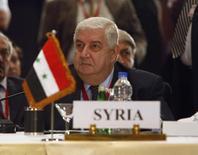 Министр иностранных дел Сирии Валид аль-Муаллем на конференции в Шарм-эш-Шейхе. 4 мая 2007 года. Министр иностранных дел Сирии на этой неделе планирует посетить Китай, сообщило во вторник МИД КНР, которая вновь пытается играть более активную роль в урегулировании сирийского кризиса. REUTERS/Tara Todras-Whitehill