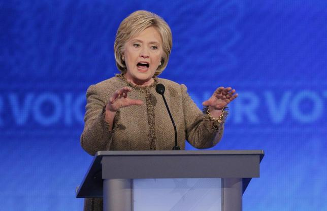 Democratic U.S. presidential candidate and former Secretary of State Hillary Clinton responds to a question about the potential use of U.S. ground troops to fight Islamic State during the Democratic presidential candidates debate at St. Anselm College in Manchester, New Hampshire December 19, 2015.  REUTERS/Brian Snyder