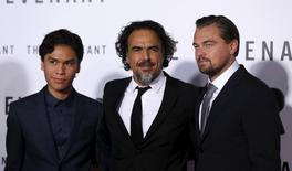 "Director of the movie Alejandro Gonzalez Inarritu (C) poses with cast members Leonardo DiCaprio (R) and Forrest Goodluck at the premiere of ""The Revenant"" in Hollywood, California December 16, 2015. REUTERS/Mario Anzuoni"