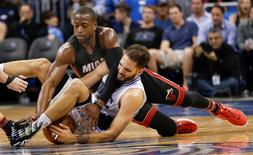 Dec 26, 2015; Orlando, FL, USA; Miami Heat guard Dwyane Wade (top) and Orlando Magic forward Evan Fournier play for the loose ball during the second half of a basketball game at Amway Center. The Miami Heat won 108-101. Mandatory Credit: Reinhold Matay-USA TODAY Sports