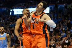 Dec 27, 2015; Oklahoma City, OK, USA; Oklahoma City Thunder guard Russell Westbrook (0) and Oklahoma City Thunder center Enes Kanter (11) celebrate after a play agains tth Denver Nuggets during the fourth quarter at Chesapeake Energy Arena. Mandatory Credit: Mark D. Smith-USA TODAY Sports