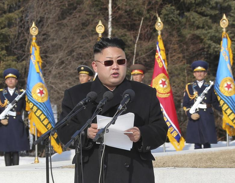 Kim Jong Un addresses commanding officers of the combined units of the Korean People's Army (KPA) in this photo released April 2, 2014. REUTERS/KCNA