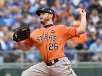 Houston Astros starting pitcher Scott Kazmir (26) throws a pitch against the Kansas City Royals in the first inning in game two of the ALDS at Kauffman Stadium.  Peter G. Aiken-USA TODAY Sports