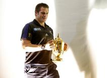 New Zealand's Richie McCaw with the Webb Ellis Cup after the press conference Action Images via Reuters / Henry Browne