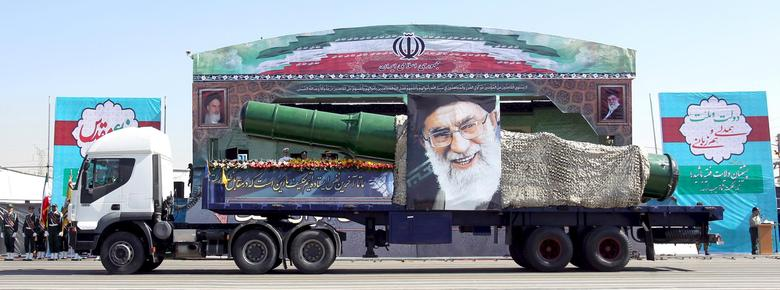 A military truck carrying a missile and a picture of Iran's Supreme Leader Ayatollah Ali Khamenei is seen during a parade marking the anniversary of the Iran-Iraq war (1980-88) in Tehran, in this September 22, 2015 file photo. REUTERS/Raheb Homavandi/TIMA
