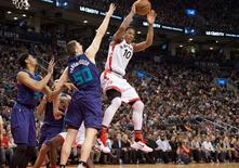Jan 1, 2016; Toronto, Ontario, CAN; Toronto Raptors guard DeMar DeRozan (10) looks to play a ball as Charlotte Hornets forward Tyler Hansbrough (50) tries to defend during the third quarter in a game at Air Canada Centre. The Toronto Raptors won 104-94. Mandatory Credit: Nick Turchiaro-USA TODAY Sports
