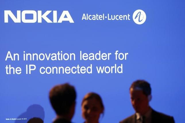 Media people attend a news conference with Nokia and Alcatel-Lucent in Paris April 15, 2015. REUTERS/Charles Platiau