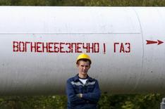 A worker stands near a pipe near a gas compressor station near the village of Volovets, western Ukraine, October 7, 2015. REUTERS/Gleb Garanich