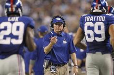 New York Giants head coach Tom Coughlin calls running back Michael Cox towards him next to defensive end Justin Trattou, in the second half of their NFL football game against the Dallas Cowboys in Arlington, Texas September 8, 2013. REUTERS/Mike Stone