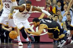 Jan 4, 2016; Cleveland, OH, USA; Cleveland Cavaliers guard Kyrie Irving (2) and Toronto Raptors guard Cory Joseph (6) go for a loose ball during the fourth quarter at Quicken Loans Arena. Mandatory Credit: Ken Blaze-USA TODAY Sports