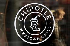 A logo of Chipotle Mexican Grill is seen on a store entrance in Manhattan, New York November 23, 2015. REUTERS/Andrew Kelly