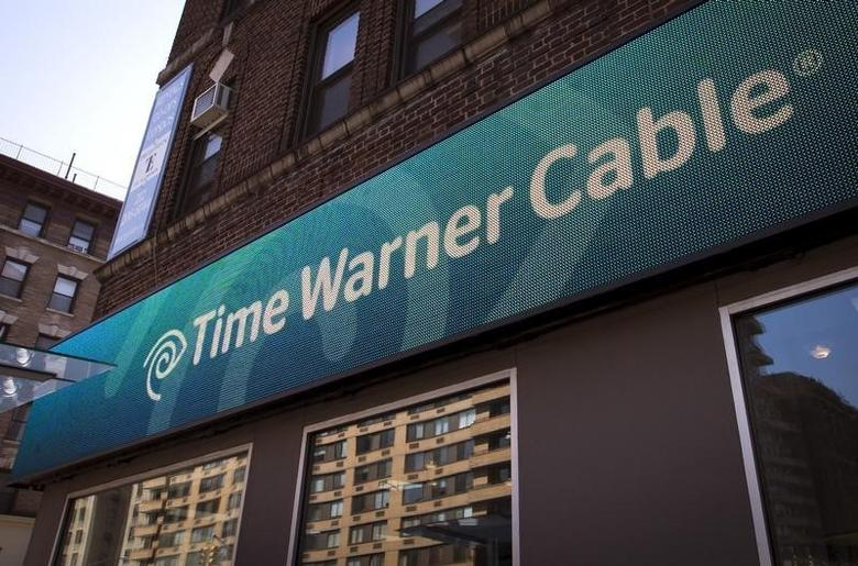 A Time Warner Cable sign and logo are seen on the exterior of a Time Warner Cable store in the Manhattan borough of New York City, May 26, 2015.   REUTERS/Mike Segar