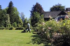 A caretaker does yard work outside a English-style mansion listed for C$17.9 million ($16.3 million) in Vancouver's historic First Shaughnessy neighbourhood July 16, 2014.   REUTERS/Julie Gordon