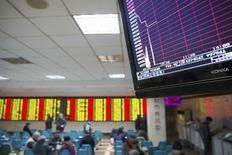 A screen showing the stock information after the new circuit breaker mechanism suspended today's stocks trading, at a brokerage house in Nanjing, Jiangsu province, China, January 7, 2016. REUTERS/China Daily