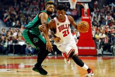 Jan 7, 2016; Chicago, IL, USA; Chicago Bulls guard Jimmy Butler (21) drives to the basket against Boston Celtics guard Marcus Smart (36) during the second half at United Center. The Bulls won 101-92. Mandatory Credit: Kamil Krzaczynski-USA TODAY Sports
