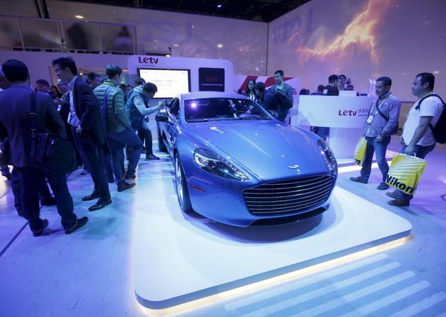 People look over a 2015 Aston Martin Rapide S in the LeTV booth during the 2016 CES trade show in Las Vegas, Nevada January 8, 2016. LeTV designed the ''Internet of the Vehicle'' system for the sports car company. REUTERS/Steve Marcus