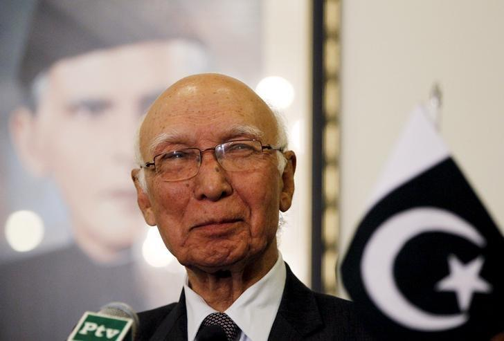 Advisor to Pakistan's Prime Minister on National Security and Foreign Affairs Sartaj Aziz listens to a question during a news conference with Iranian Foreign Minister Javad Zarif at the Foreign Ministry in Islamabad April 8, 2015. REUTERS/Caren Firouz/Files