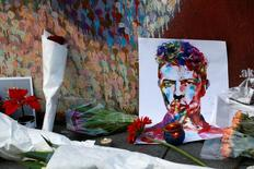 Tributes are seen next to a mural of David Bowie in Brixton, south London, January 11, 2016. REUTERS/Stefan Wermuth