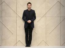 "Burberry Chief Executive Christopher Bailey walks onto the catwalk following the Burberry Prorsum Autumn/Winter 2014 collection during ""London Collections: Men"" in London January 8, 2014.  REUTERS/Suzanne Plunkett"
